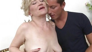Blonde granny with saggy tits loves young cock thumb