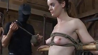 Slaves are made to undress inside a small cage thumb