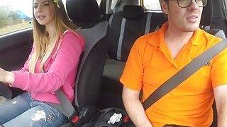 Natural busty babe bangs in driving school car thumb