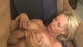 Horny MILF Emma Starr getting thrusted from behind and giving titjob thumb