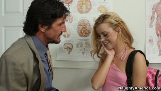 Blonde college girl Jessie Rogers practices what she has learnt in anatomy class thumb