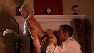 Outrageously hot blonde Brooke Haven gives blowjob by the fire place thumb
