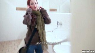 Kinky slut Belinda sucks a cock in the public toilet for money thumb