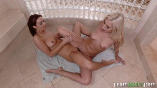 Slutty lesbians are fucking in the shower using large dildo thumb
