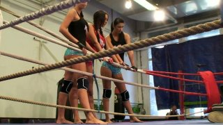 Brunette chick Emma Butt fights her girlfriends on the boxing ring thumb