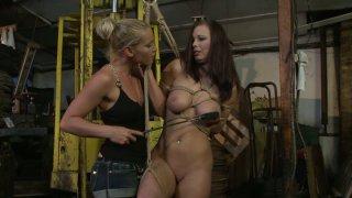 Kathia Nobili ties up bosomy brunette Zyna Babe and spanks her thumb