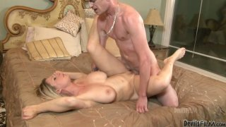 Busty blonde babe Devon Lee gets poked hard in a missionary position and then gives a hot titjob thumb