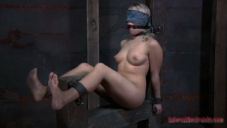 Blindfolded Sophie Ryan is fucked with a sex machine thumb