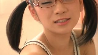Japanese_nerdy_girl_Ami_Tokito_in_her_pink_bedroom thumb