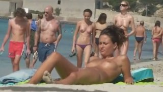Busty nude babe  spied upon on Barcelona beach thumb