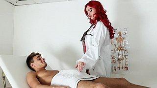 Redhead massages a big dick before sex thumb