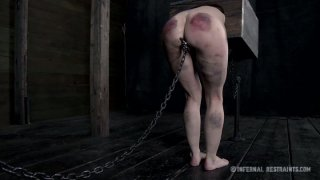 Submissive slut Elise Graves gets her nostrils chained to the wall thumb