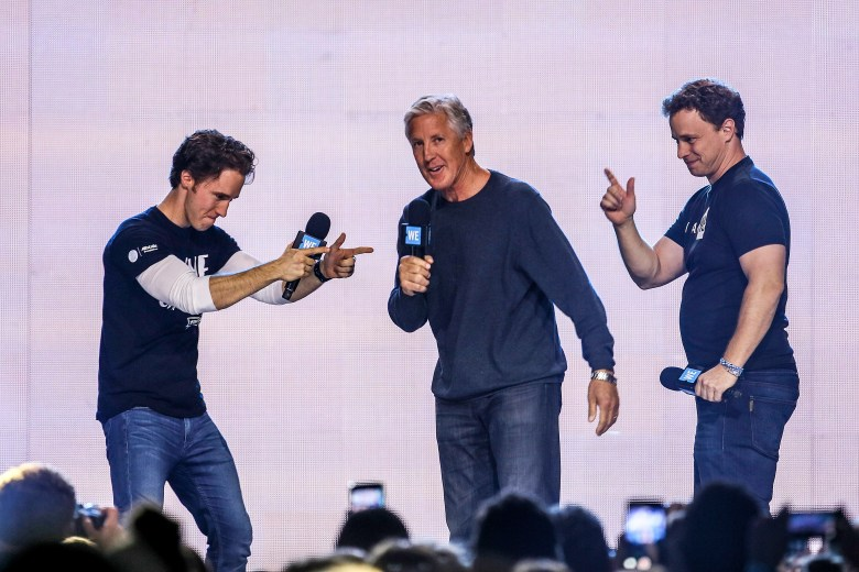 Craig and Marc Kielburger and Seahawks Coach Pete Carroll at We Day Seattle 2017