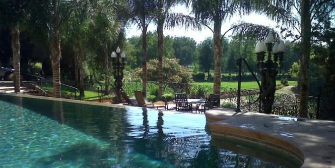 In The Heart Of Lodi Wine Country Surrounded By 180 Acres Vineyard An Arching Bridge Crossing Koi Ponds Leading To A Waterfall And Botanical Garden