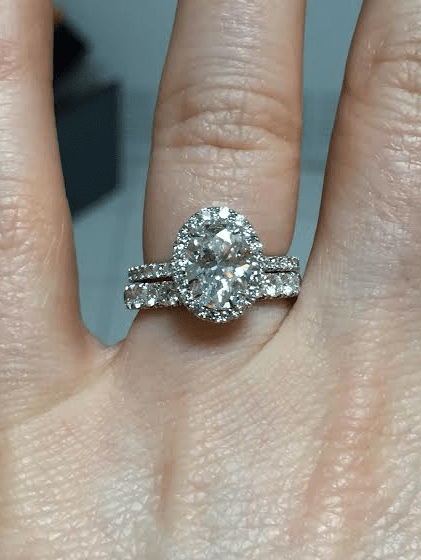 i have mine with an eternity band when my husband proposed i noticed that a band would not sit flush against the ring due to the underside basket
