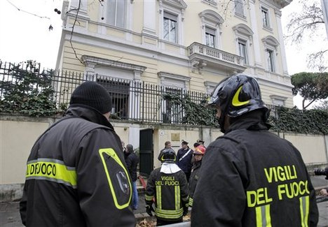 Firefighters stand outside the Greek Embassy in Rome, Monday, Dec. 27, 2010. A package bomb was found at the Greek Embassy in Rome on Monday, four days after similar mail bombs exploded at two other embassies injuring two people. The device was defused and no one was injured. Carabinieri Col. Maurizio Mezzavilla said the parcel bomb at the Greek Embassy was similar to the ones that exploded Thursday at the Chilean and Swiss embassies. An anarchist group with reported ties to Greek anarchists claimed responsibility for those blasts.