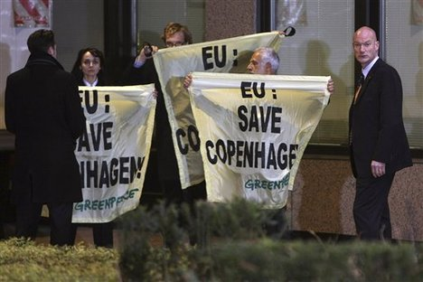 Greenpeace activists are taken away by plainclothes security, at the start of a two-day EU summit, at the European Council building in Brussels, Thursday, Dec. 10, 2009.