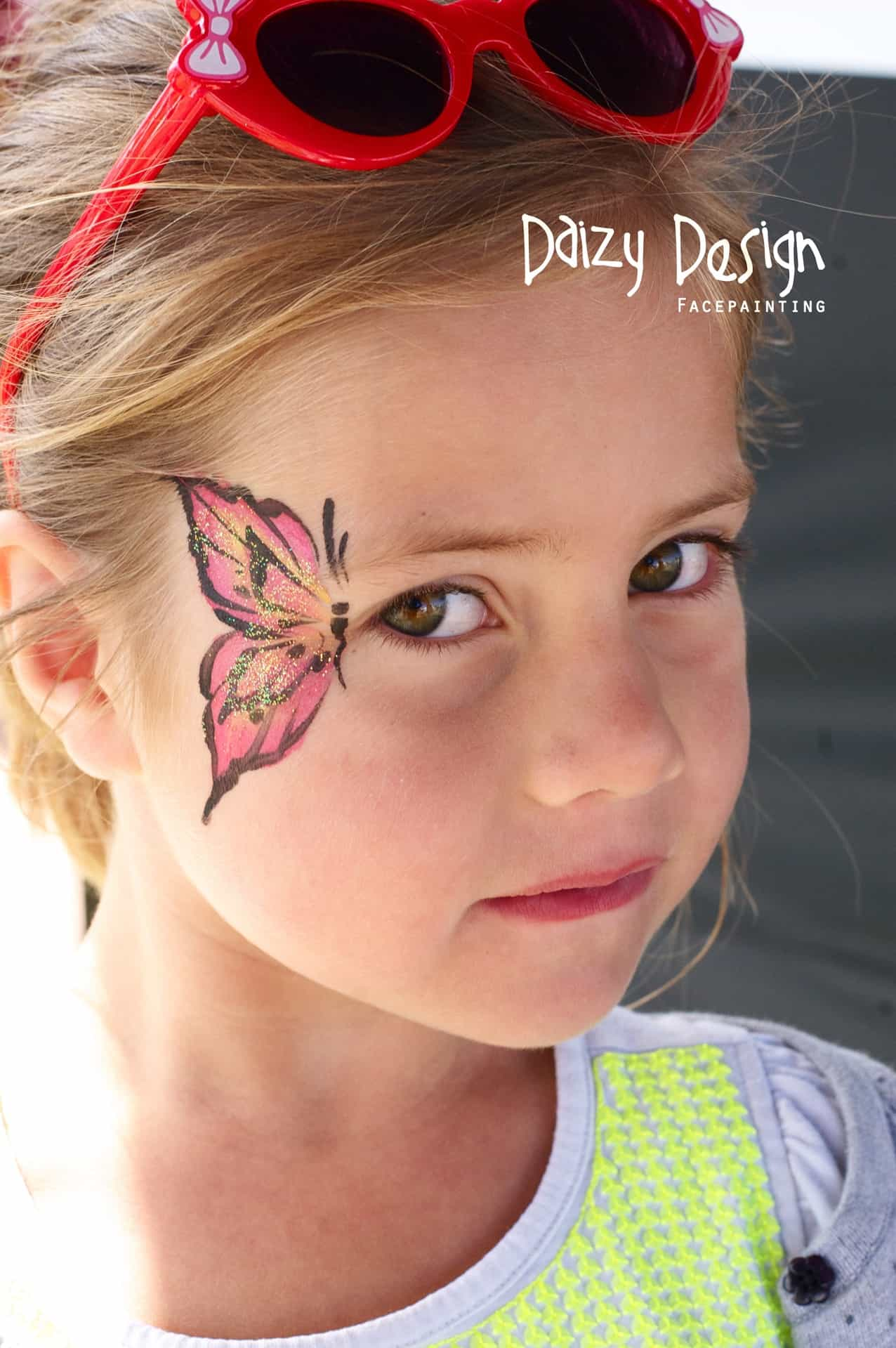 Cute Face Painting Designs for Your Kids This Summer VIEW IN GALLERY Simple side butterfly