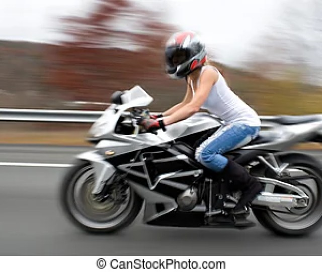 Blonde Biker Girl Abstract Blur Of A Pretty Girl Driving A