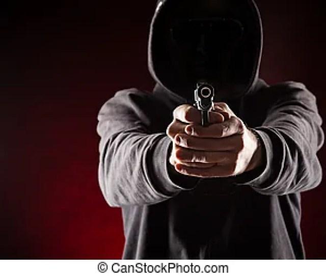 Killer With Gun Close Up Over Dark