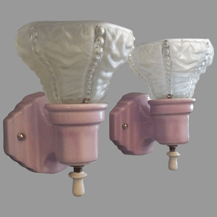 mauve pink porcelain wall sconces with frosted clear textured glass shades