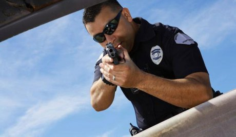 Image result for cop sensing a suspect about to pull out a gun