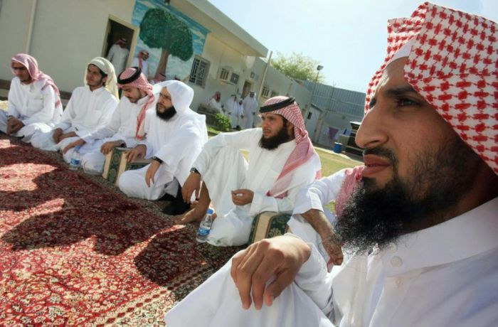 Saudi men released from Guantanamo Bay, and from Saudi and Iraqi prisons, listen to a preacher at a Saudi government terrorist rehabilitation center (HASSAN AMMAR/AFP/Getty)