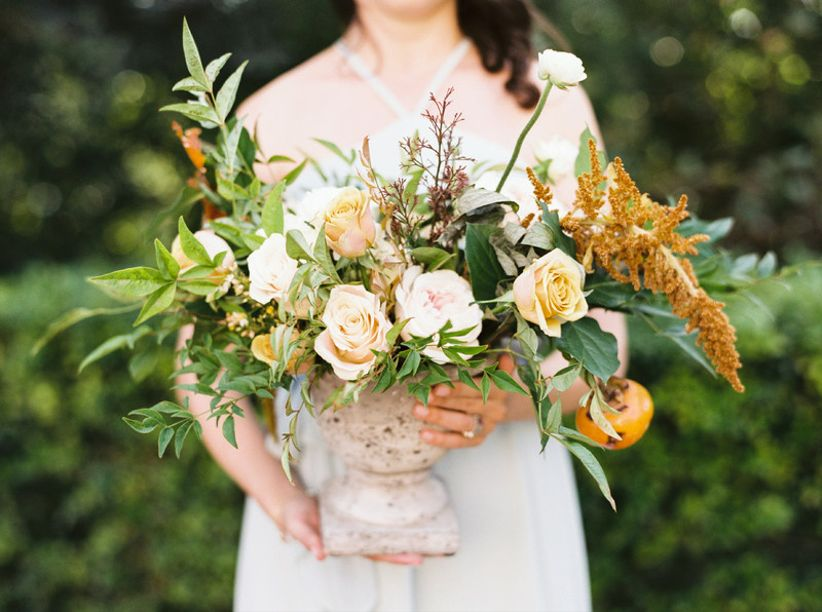 fall wedding centerpiece with greenery and yellow amaranthus