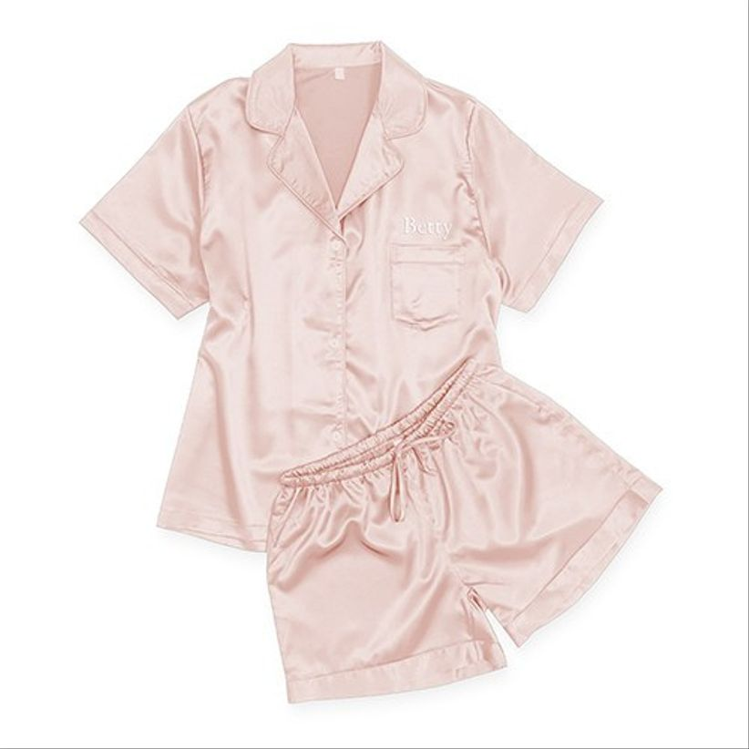 blush pink satin pajama set with short-sleeve button down top and matching shorts