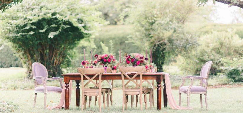 13 Types of Wedding Chairs for a Stylish Big Day   WeddingWire outdoor wedding tablescape with X back chairs