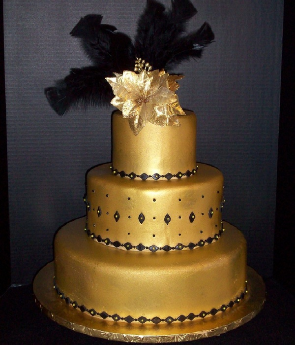 Unconventionally Beautiful   Black and Gold Wedding Cakes     Gold And Black Wedding Cake Brides Request Was A Gold Fondant Black Trim  Black Feathers Black