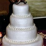 White Textured Buttercream With Handmade Fondant Pearl