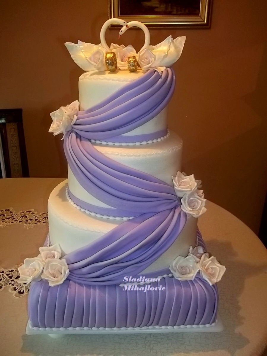 White Purple Wedding Cake Swans Roses Cakecentral Com
