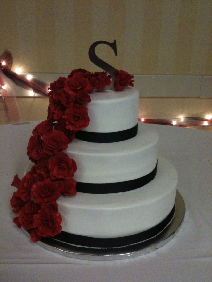 Cascading Red Roses On Buttercream Wedding Cake