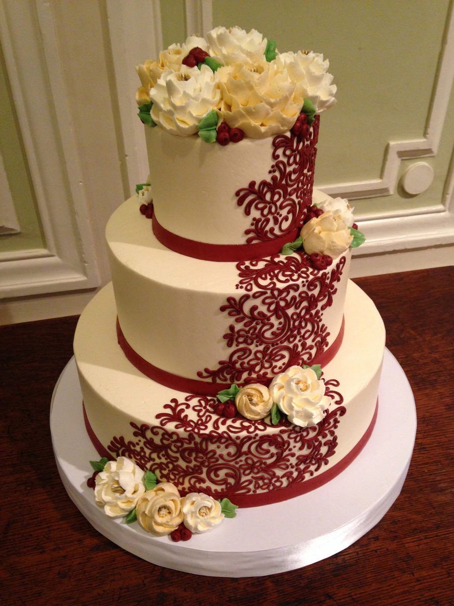 3 Tier Buttercream Wedding Cake With Red Scrolling