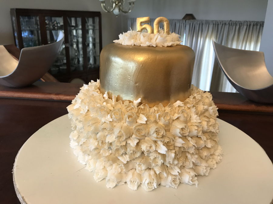 50Th Wedding Anniversary In Gold And White Flowers