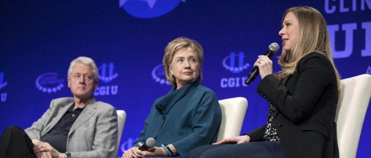 Former President Bill Clinton (L) and former Secretary of State Hillary Clinton (C) watch their daughter and Vice Chair of the Clinton Foundation Chelsea Clinton. (Reuters/Samantha Sais) / Reuters