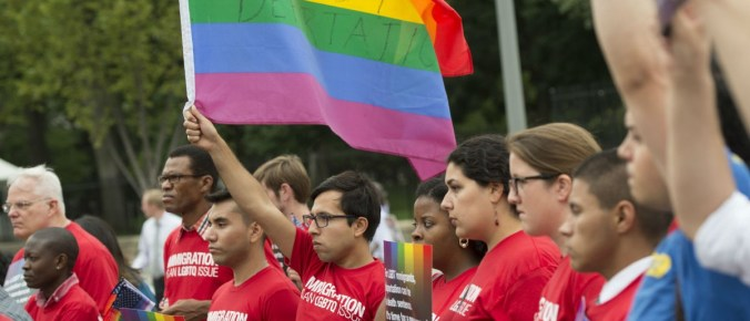 Demonstrators with the group GetEQUAL hold a protest with lesbian, gay, bisexual and transgender (LGBT) individuals affected by the country's immigration policies during a rally outside the White House in Washington, DC, September 9, 2014. AFP PHOTO / Saul LOEB/Getty Images