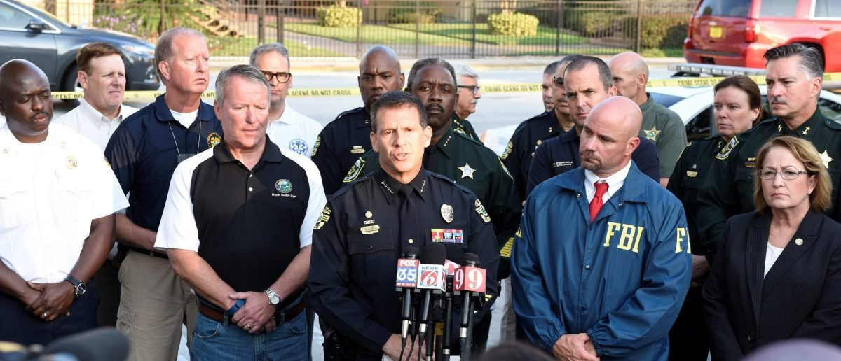Orlando Police Chief John Mina and other city officials answer the media
