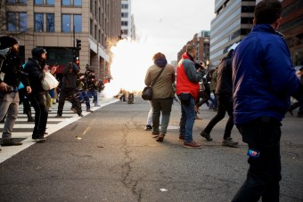 A concussion grenade explodes among protesters and reporters - Daily Caller - Grae Stafford