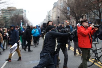 Bricks being thrown at police by protesters - Daily Caller - Grae Stafford