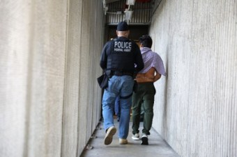 A U.S. Immigration and Customs Enforcement's (ICE) Fugitive Operations team member arrests an Iranian immigrant in Santa Ana, California, U.S., May 11, 2017. REUTERS/Lucy Nicholson