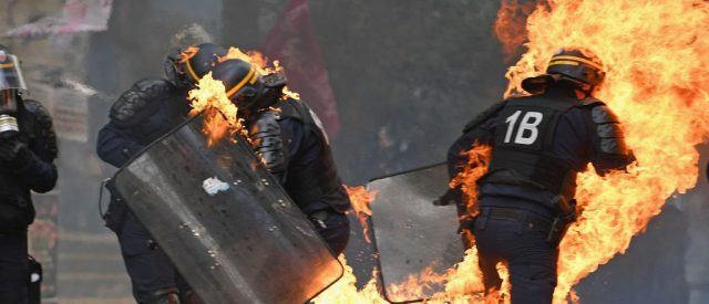 Cops Engulfed In Flames At May Day Protest, Forced To Deal With Flaming Dragon [VIDEO]