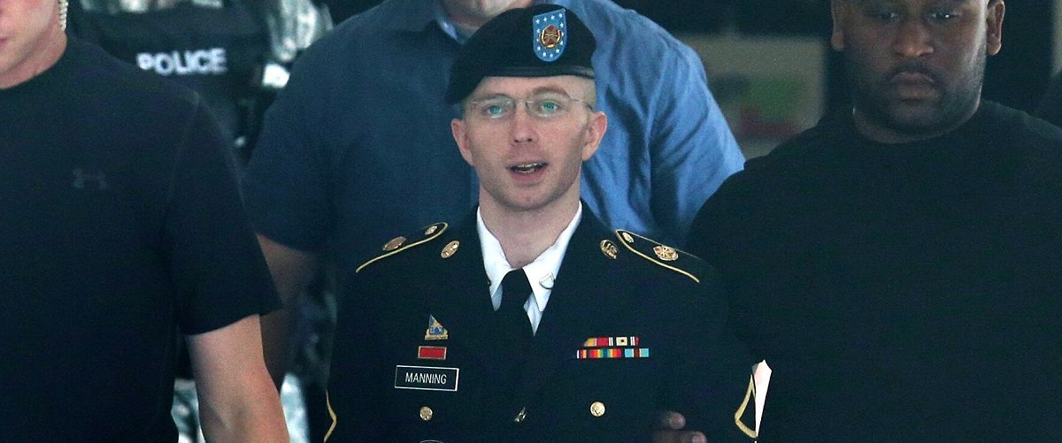U.S. Army Private First Class Bradley Manning (C) is escorted by military police as he leaves his military trial after he was found guilty of 20 out of 21 charges, July 30, 2013 Fort George G. Meade, Maryland. Manning, was found not guilty of aiding the enemy, was convicted of wrongfully causing intelligence to be published on the internet, is accused of sending hundreds of thousands of classified Iraq and Afghanistan war logs and more than 250,000 diplomatic cables to the website WikiLeaks while he was working as an intelligence analyst in Baghdad in 2009 and 2010. Mark Wilson/Getty Images.