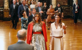 HAMBURG, GERMANY - JULY 08: First Mayor of Hamburg Olaf Scholz receives (background L-R) Melania Trump, wife of US President Donald J. Trump, Joachim Sauer, husband of German Chancellor Angela Merkel, Juliana Awada, wife of the President of Argentina Mauricio Macri and other partners of Heads of State and Governments, plus respresentatives of guest invitees during the partner program of G20 summit on the second day of the G20 summit at Hamburg Town Hall on July 8, 2017 in Hamburg, Germany. Leaders of the G20 group of nations are meeting for the July 7-8 summit. Topics high on the agenda for the summit include climate policy and development programs for African economies. (Photo by Friedemann Vogel - Pool/Getty Images)