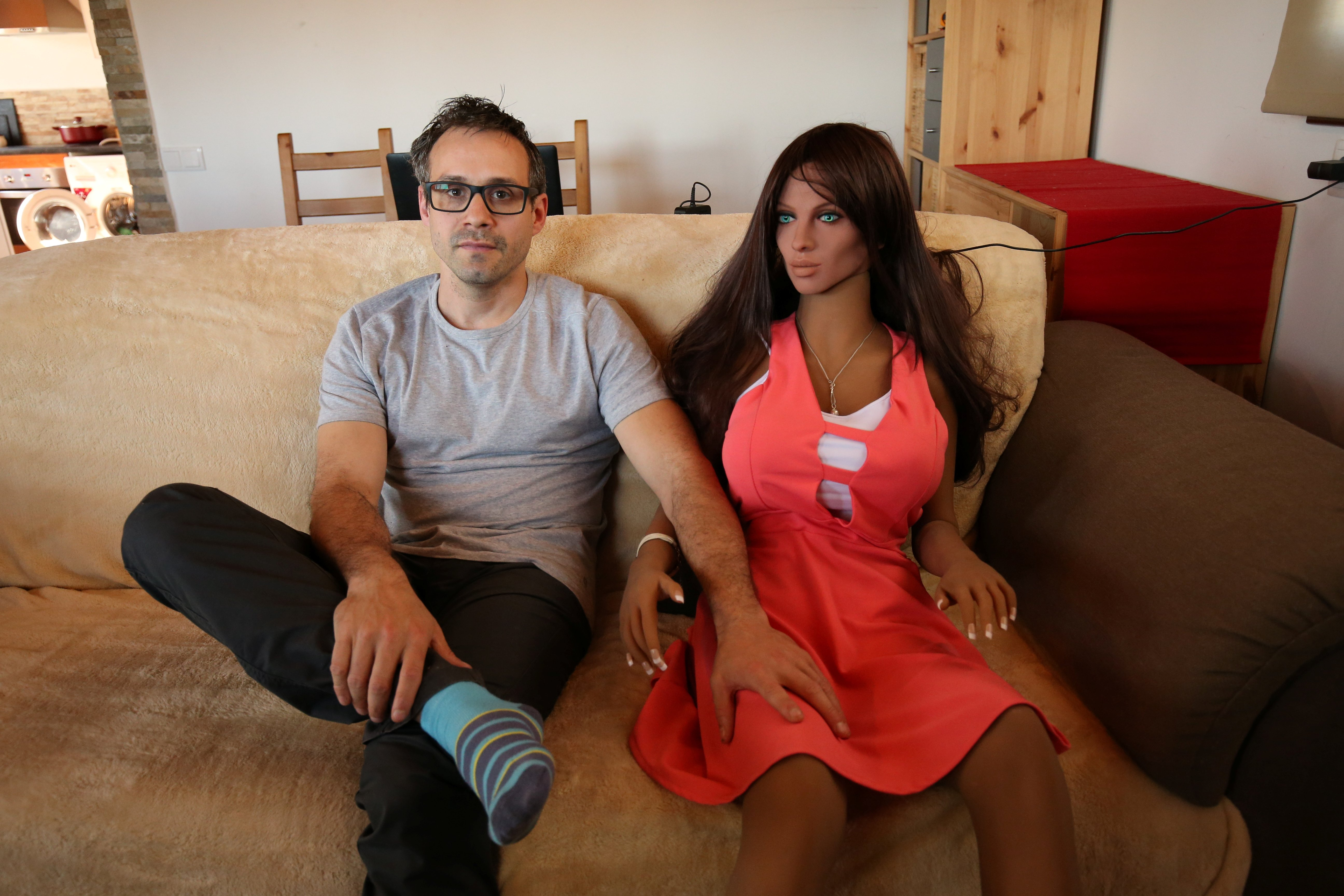 Catalan nanotechnology engineer Sergi Santos poses beside Samantha, a sex doll packed with artificial intelligence providing her the capability to respond to different scenarios and verbal stimulus, in his house in Rubi, north of Barcelona, Spain, March 31, 2017. REUTERS/Albert Gea