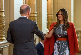U.S. First Lady Melania Trump is greeted by Hamburg mayor Olaf Scholz during a G20 leaders spouses event at the townhall during the G20 summit in Hamburg, Germany July 8, 2017 REUTERS/Jens Buettner, Pool - RTX3AM9Z