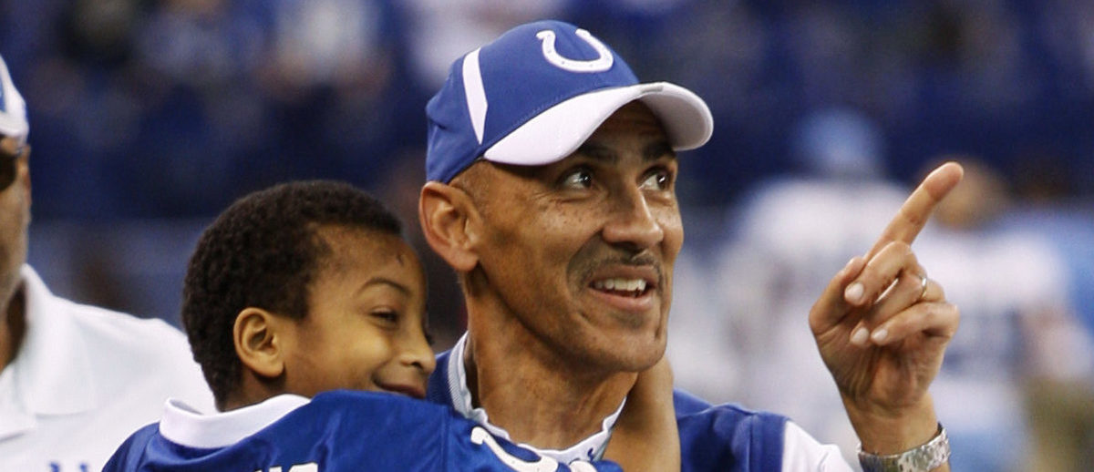 Indianapolis Colts head coach Tony Dungy carries his son Jordan from the field after beating the Tennessee Titans in their NFL game in Indianapolis December 28, 2008. REUTERS/Brent Smith