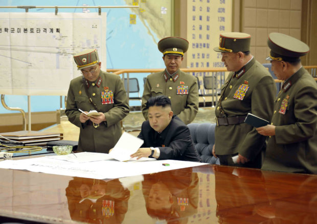 North Korean leader Kim Jong-un (C) presides over an urgent operation meeting on the Korean People's Army Strategic Rocket Force's performance of duty for firepower strike at the Supreme Command in Pyongyang, early March 29, 2013, in this picture released by the North's official KCNA news agency. REUTERS/KCNA
