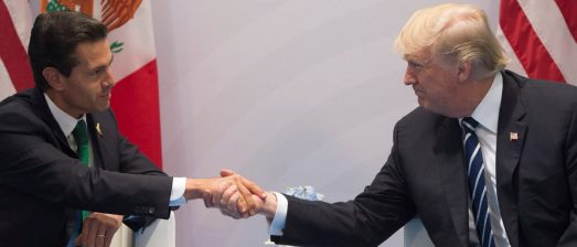 US President Donald Trump and Mexican President Enrique Pena Nieto shake hands during a meeting on the sidelines of the G20 Summit in Hamburg, Germany, on July 7, 2017. PHOTO: Getty Images/AFP/SAUL LOEB